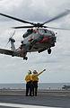 US Navy 030906-N-1281L-010 Airman Apprentice Antwan Robinson, from Villa Rica, Ga., gives a signal to a SH-60F Seahawk pilot.jpg
