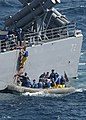 US Navy 040310-N-1082Z-054 Crewmembers assigned to the guided missile cruiser USS Vella Gulf (CG 72) transport passengers returning from the nuclear powered aircraft carrier USS George Washington (CVN 73) in a Rigid Hull Inflat.jpg