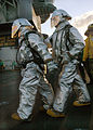 US Navy 040430-N-0119G-003 Sailors assigned to Air Department's Crash and Salvage team prepare to enter the scene of a simulated fire.jpg