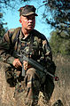 US Navy 040727-N-9712C-003 Builder 1st Class William Key watches for aggressing forces on a squad leader security patrol.jpg