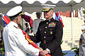 US Navy 041008-N-8861F-002 Adm. Gregory Johnson passes the command colors to Supreme Allied Commander Europe, Gen. James L. Jones, signifying Johnson's official end as Commander Naval Forces Europe.jpg