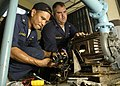 US Navy 050115-N-1229B-081 U.S. Navy Chief Electrician's Mate Conrad Capindo, left, and Lieutenant Junior Grade Brad Dandurand both deployed aboard USS Abraham Lincoln (CVN-72), inspect electrical power feeds at a hospital in B.jpg