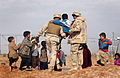 US Navy 050124-N-1810F-487 Ens. Majid Awad from Bahrain, assist a local Iraqi child.jpg