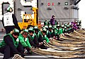 US Navy 050218-N-5884M-001 Sailors assigned to the Air Department aboard the Nimitz-class aircraft carrier USS Dwight D. Eisenhower (CVN 69), stretch out the ship's emergency landing barricade during flight deck drills.jpg
