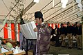 US Navy 050228-N-2970T-010 Attendees bows their heads as a Shinto Priest reads a prayer during a Navy Exchange groundbreaking ceremony held on board U.S. Fleet Activities Sasebo, Japan.jpg