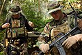 US Navy 050312-N-5781F-010 Aviation Ordnanceman 1st Class Brian Fitzgerald, right, assigned to Explosive Ordnance Disposal Mobile Unit Five (EODMU-5), checks his weapon before heading out to a target area during jungle warfare.jpg