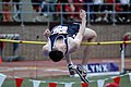 US Navy 050429-N-7975R-004 Midshipman 3rd Class Stephen Whites looks for a landing area as he clears the bar during the high jump competition at the University of Pennsylvania's Penn Relays.jpg