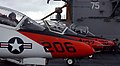 US Navy 050624-N-5345W-097 Three T-45A Goshawk trainer aircrafts assigned to Training Air Wing One rest in front of the island on the flight deck aboard USS Harry S. Truman (CVN 75) while pilots prepare for their turn to launch.jpg