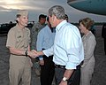 US Navy 051010-N-9274T-015 Commanding Officer, Naval Air Station Joint Reserve Base (NAS JRB) New Orleans, Capt. A.J. Rizzo, greets President George W. Bush and First Lady Laura Bush.jpg