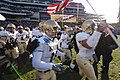 US Navy 051203-N-9693M-003 The Naval Academy Midshipmen take to the field during opening ceremonies for the 106th playing of Army vs. Navy Football game.jpg
