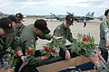 US Navy 060310-N-9583M-239 Officers from Fighter Squadron Three One (VF-31) pick up roses to give to loved ones upon returning from a six month deployment in support of maritime security operations and the global war on terrori.jpg