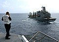 US Navy 060909-N-2651J-016 Quartermaster 2nd Class Jason Lentz checks the distance between the U.S. Military Sealift Command (MSC) supply ship USNS Leroy Grumman (T-AO 195) and the amphibious assault ship USS Saipan (LHA 2).jpg