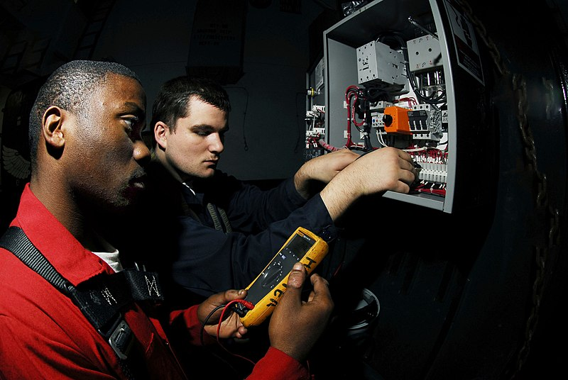 File:US Navy 070122-N-3729H-039 Electrician's Mate Fireman Cecil Harper, left, and Electrician's Mate Fireman James Werderman, check circuit connections on a cardboard disposal system aboard the Nimitz-class aircraft carrier USS Joh.jpg