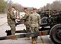 US Navy 070307-N-9274T-003 Staff Sgt. Robert Reynolds, Sgt. Harold Subia, and Sgt. Christopher Sepeda prepare to load a WWII era howitzer at the Naval Air Station Joint Reserve Base New Orleans old airfield.jpg