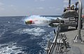US Navy 070412-N-9851B-007 A MK-46 exercise torpedo is launched from the deck of Arleigh Burke-class guided-missile destroyer USS Mustin (DDG 89) during a torpedo launch exercise.jpg