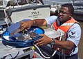 US Navy 070419-N-0857S-001 Electrician's Mate 2nd Class Randy Norris assembles the inside of the navigation radar for the 25-foot utility boat at Naval Support Activity (NSA) New Orleans.jpg