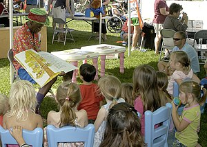 Wally Amos - Wally Amos takes children on a reading adventure during Springfest, an event that celebrates children during the Month of the Military Child on Naval Station Pearl Harbor, April 21, 2007
