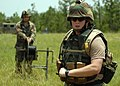 US Navy 070619-N-3857R-004 Personnel Serviceman 3rd Class Ray Guedry assigned to Naval Mobile Construction Battalion (NMCB) 1 pull communications wire across the battalion's forward operating base at Camp Shelby.jpg