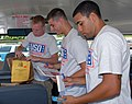 US Navy 070727-N-4459K-010 Sailors assigned to the Precommissioning Unit (PCU) George H. W. Bush (CVN 77), sort school supplies for the Stuff the Bus Campaign.jpg