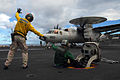 US Navy 070809-N-2659P-040 Lt. Christopher Smith signals to Aviation Boatswain's Mate (Equipment) Airman James Christaudo before launching an E-2C Hawkeye assigned to Carrier Airborne Early Warning Squadron (VAW) 112.jpg