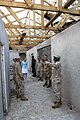 US Navy 070930-F-9074R-010 A group observes the work done by a U.S. Navy Mobile Construction Battalion during a tour of the Combined Joint Task Force-Horn of Africa project.jpg