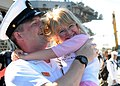US Navy 081008-N-6736G-061 Chief Aviation Warfare Systems Operator Michael Ousley embraces his daughter after the aircraft carrier USS Abraham Lincoln (CVN 72) moors pier side at Naval Station North Island.jpg
