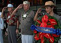 US Navy 081207-N-3283M-173 Pearl Harbor survivor Lou Conter, center, and National Park Service Ranger Nancy Reames renders a salute before hanging a wreath in honor of USS Arizona (BB 39).jpg