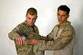 US Navy 081226-A-6851O-152 Hospital Corpsman 3rd Class Wesley Gause, from Wisville, Texas, and Marine Cpl. William James, from San Diego, both assigned to U.S. Marines 0731 Military Training Team, demonstrate how to apply a pre.jpg