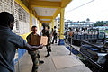 US Navy 090108-N-9995B-003 Sailors from Maritime Expeditionary Detachment 221 and members of the Jamaica Defense Force deliver a shipment of textbooks from a Project Handclasp shipment at a local school during Southern Partners.jpg