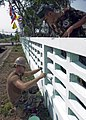 US Navy 090212-N-5253W-034 Construction Mechanic 3rd Class Jeff Schroeder, from Beatty, N.V., left, assigned to Combat Logistics Regiment 3 of the 31st Marine Expeditionary Unit, works with Royal Thai Marines to paint a fence.jpg