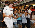 US Navy 090222-N-1113S-003 Musician 3rd Class Nina Church leads children in a dance at the SM City North EDSA Mall.jpg