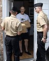 US Navy 090608-N-9599T-462 Electrician's Mate 1st Class Louis Meister and Yeoman 1st Class Bruce Casteel-DeAlmeida, both assigned to the ballistic-missile submarine USS Tennessee (SSBN-734), deliver Meals-on-Wheels.jpg