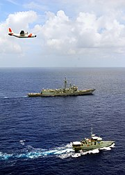 US Navy 090625-G-0314D-001 A U.S. Coast Guard Air Station Barbers Point C-130 crew flies over USS Crommelin (FFG 37), homeported in Pearl Harbor, Hawaii, and the FSS Independence, a patrol boat from the Federated States of Micr