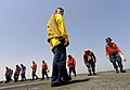 US Navy 090914-N-5345W-193 Boatswain's Mate 1st Class Israel Idrovo leads the flight deck team of the dock landing ship USS Fort McHenry (LSD 43) during a foreign object debris walkdown before scheduled flight operations.jpg