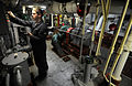 US Navy 100213-N-1688B-073 Engineman 3rd Class Anthony Cusson downloads data from the distilling plant aboard the guided-missile cruiser USS Hue City (CG 66) onto a Palm Pilot for review by a computer.jpg