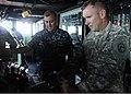 US Navy 100228-N-0808P-196 Lt. Gen. P.K. (Ken) Keen, commander of Joint Task Force Haiti, takes the helm of the amphibious dock landing ship USS Carter Hall (LSD 50).jpg