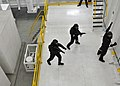 US Navy 100708-N-7643B-099 Two Republic of Singapore Navy sailors advance on a suspect during a simulated boarding exercise in the boarding and search trainer.jpg