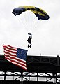 US Navy 100810-N-5366K-213 Aircrew Survival Equipmentman 1st Class Thomas Kinn, assigned to the U.S. Navy parachute demonstration team, the Leap Frogs, makes his final approach to land with an American flag.jpg