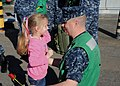 US Navy 100929-N-1325N-002 The daughter of Chief Missile Technician Derick Stonesifer gives her father the first hug as the Ohio-class ballistic-mi.jpg