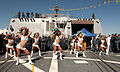 US Navy 101109-N-7948C-054 Miami Dolphins cheerleaders perform for the Sailors aboard the guided-missile destroyer Pre-Commissioning Unit (PCU) Ja.jpg