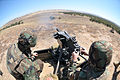 US Navy 110618-N-IL826-750 Seabees fire the MK-19 automatic grenade launcher during the weapons phase of Unit Level Training and Readiness Assessme.jpg