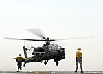 US Navy 110719-N-UT455-143 For the first time, an Apache helicopter lands on the deck of a U.S. Navy ship.jpg