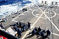 US Navy 111213-N-ZF681-525 Sailors fire the M4A1 carbines during small arms qualifications on the flight deck of the guided-missile destroyer USS H.jpg