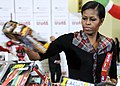 US Navy 111216-F-ZE674-310 First lady Michelle Obama visits Joint Base Anacostia-Bolling, to sort toys for the Toys for Tots charity.jpg