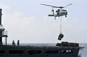 US Navy 120103-N-ZI635-691 A helicopter retrieves supplies.jpg