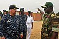 US Navy 120215-N-IZ292-243 Cmdr. Leonard Milliken, commanding officer of the guided-missile frigate USS Simpson (FFG 56), is briefed by Nigerian na.jpg