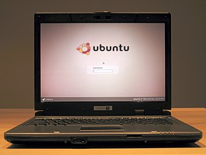 A System76 laptop displays the Ubuntu Edgy log...