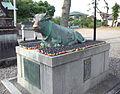 Ueno Ten'man-gû Shintô Shrine - Bronze statue of a cattle lying down.jpg