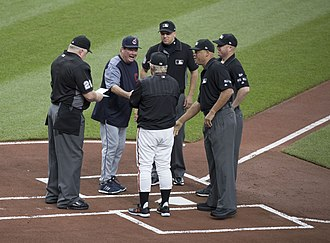 Umpire (baseball) - An MLB umpiring crew meeting with the managers from each team before a 2017 game