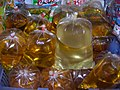 Vegetable oil in plastic bags for sale - Thailand.JPG